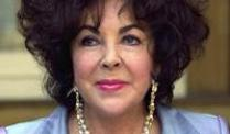 Eine Puppe soll an Elizabeth Taylor erinnern.