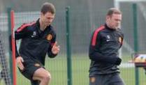 Champions League: Real vs United - Glamour-Duell der Königsklasse. Jonny Evans (l) und Wayne Rooney beim ManUnited-Training.