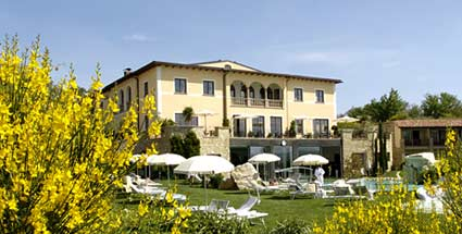The main outdoor thermal pool of the adler hotel in bagno vignoni