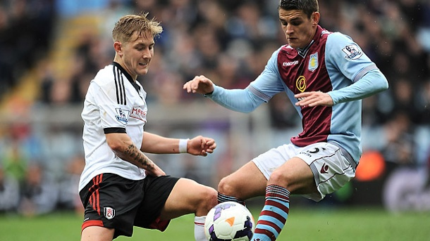 Felix Magath und Lewis Holtby vom FC Fulham hoffen wieder. Lewis Holtby vom FC Fulham (links) und Aston Villa's Ashley Westwood kämpfen um den Ball. (Quelle: AP/dpa)