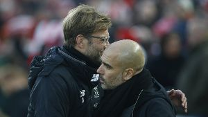 Jurgen Klopp manager of Liverpool and Josep Guardiola manager of Manchester City hug during the prem