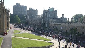 Windsor United Kingdom Invited Royal fans outside St Georges Chapel at the Royal W