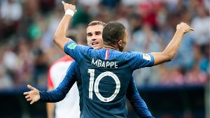 MOSCOW RUSSIA – JULY 15 2018 France s Antoine Griezmann L and Kylian Mbappe celebrate scoring i