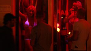 Tourists looks for girls at Red Light District in Amsterdam Netherlands