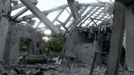 A damaged house that was hit by a rocket can be seen north of Tel Aviv