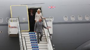 Prince Charles of England C and wife Camila back Duchess of Cornualles get off their plane as