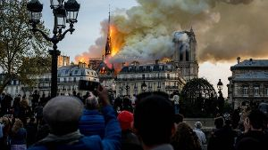 April 15 2019 Paris France People watch the landmark Notre Dame Cathedral burning in central P