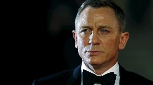 Daniel Craig poses for photographers as he attends the world premiere of the new James Bond 007 film 'Spectre' at the Royal Albert Hall in London, Britain