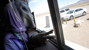 August 5 2014 Rachel Nevada U S A masked figure representing an alien greets patrons at the