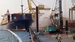 A crane collapses after the Soul of Luck ship slams into a pier in Tanjung Emas, Semarang