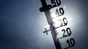Sonne hinter Thermometer