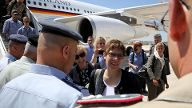 German Defence Minister Annegret Kramp-Karrenbauer is welcomed upon her arrival at Marka military airport in Amman