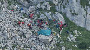 Mountain rescue team (TOPR) members are seen near cave entry during a search mission to save two cavers trapped in a cavern in Poland's Tatra mountains, near Zakopane