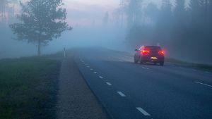 Tartumaa 22 05 2019 Fog foggy night nature spring norhtern twilight sunset Car on the road wi