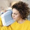 Woman listening to music with portable radio at home model released Symbolfoto property released PUB (Quelle: imago images/Westend61)