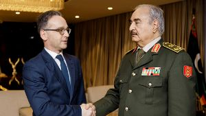 German Foreign Minister Maas shakes hands with Libya's commander Khalifa Haftar in Benghazi