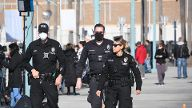 LAPD officers patrol the walk way as the USNS Mercy arrives in the port of Los Angeles Friday FRIDAY March 27,2020. Los