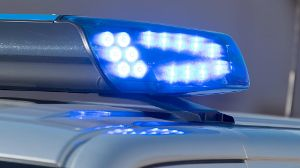 Detail shot of a glowing blue light on a police car Detail shot of a glowing blue light on a police