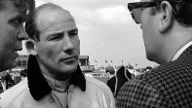 Stirling Moss GBR Rob Walker Lotus had a fraught race running second in his own car until retiri