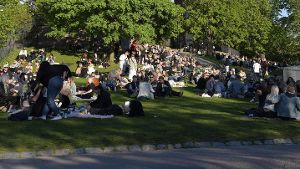 Finnish youths gather in a park to celebrate the end of the school year and warm weather in Helsinki, Finland on Friday