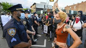 A protester faces police when Black Lives Matter protesters clash with NYPD officers as protests continue over the death