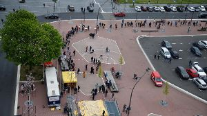 People wait to get vaccinated at mobile vaccination centre in Cologne